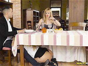 Waitress blondie Fesser sneaky man rod sucking under the table