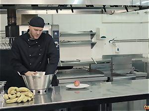 Chef Nacho Vidal porks his fresh chief in the kitchen
